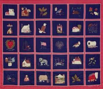 "The had made quilt squares were sewn together for this ""Our Hearts Are In Laurel"" quilt. This quilt was sold to pay for some of the cost to create the history book."